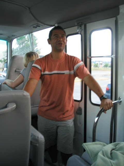 Pastor Dago greets us on his bus