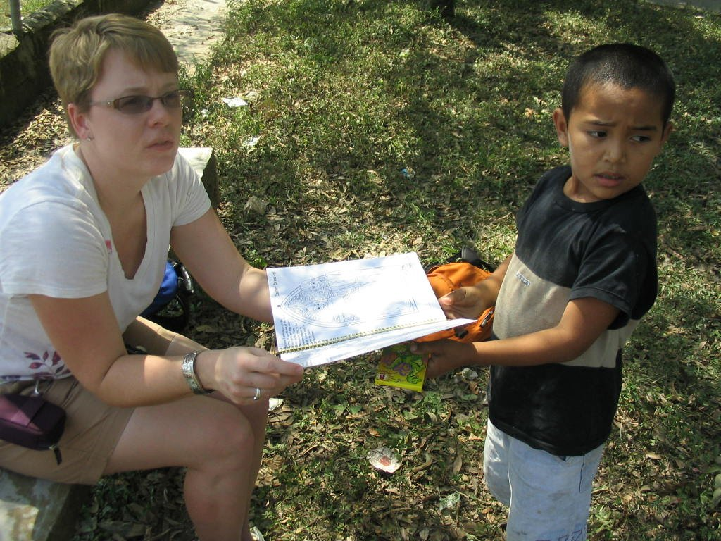 Rachel handing out coloring books in Loma Alta