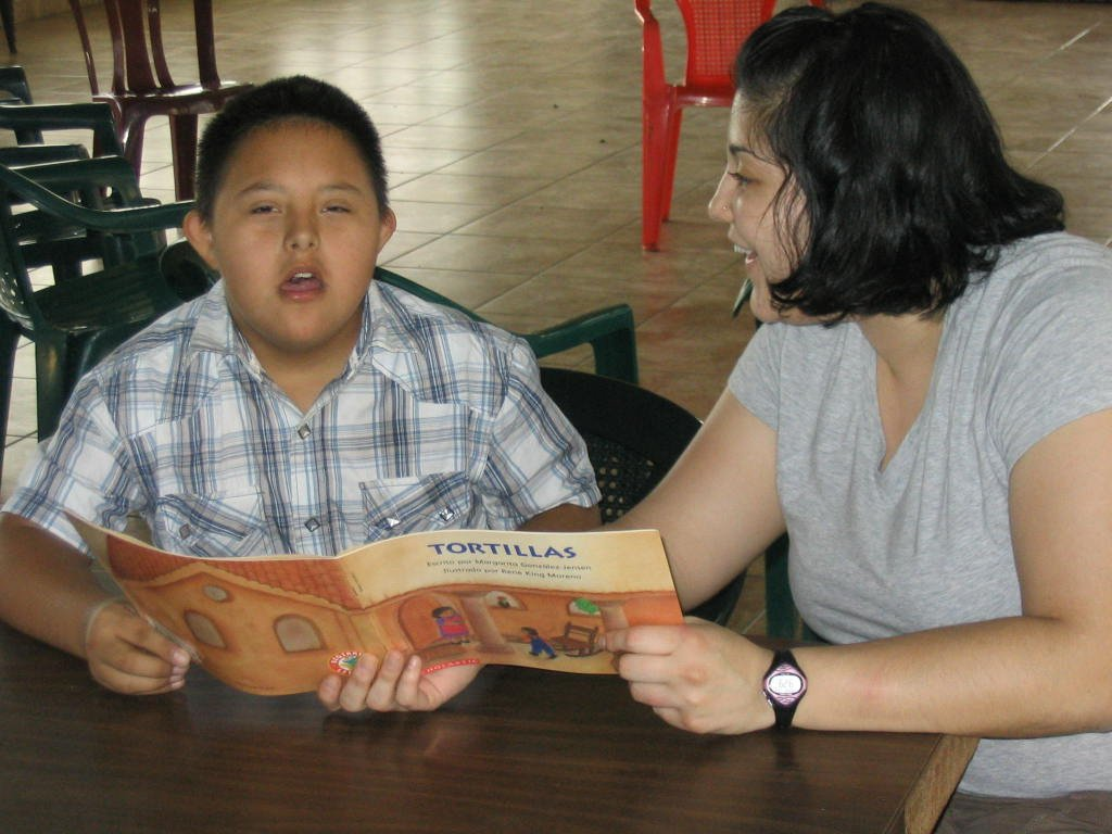 Rui doing a reading exercise with Brayan