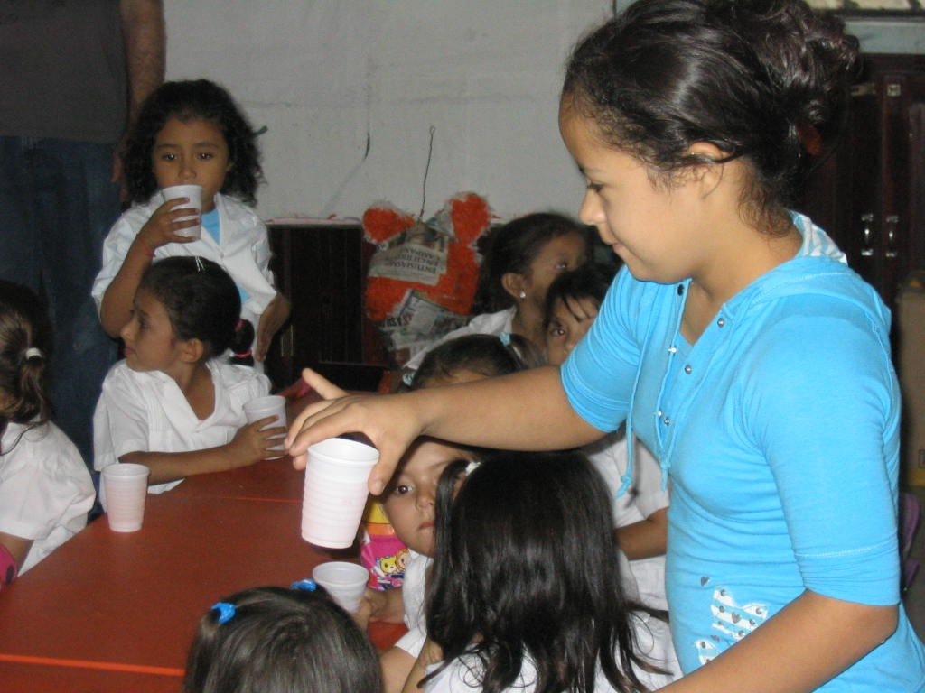 Ingrid, who has Down syndrome, passing out a snack to the school kids