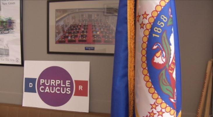 Purple Caucus sign