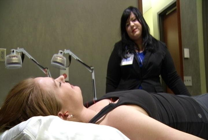 Acupuncturist Sara Bublitz demonstrates acupuncture treatment