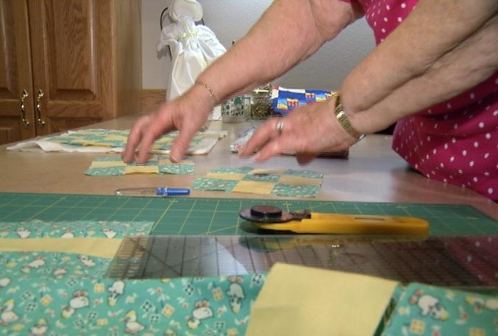 Priscilla Golly demonstrates how to make a 9-patch quilt.