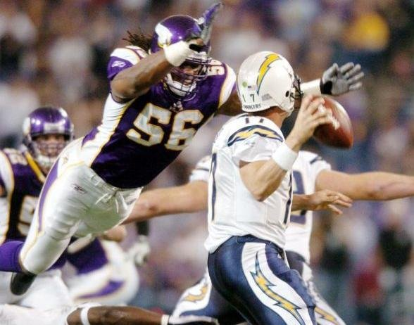 Vikings linebacker E.J. Henderson in flight