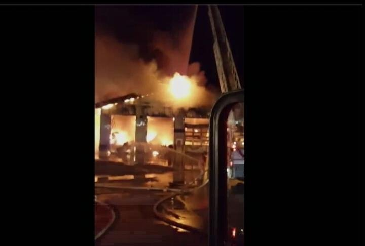 Flames consumed a truck service center in Racine early Friday morning