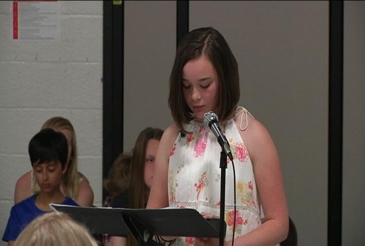 Charlotte's sister, Grace, speaks about the family's medical journey at Folwell Elementary.