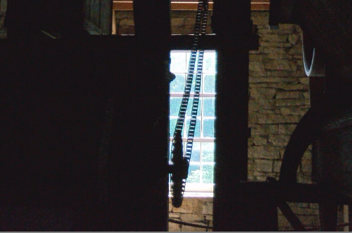 The dark interior of the mill makes for a sharp contrast with a bright summer day.