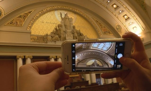 KTTC's Shannon Rousseau takes a picture inside the Minnesota House chambers during a tour.