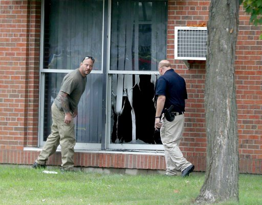 (David Joles/Star Tribune via AP). Law enforcement officials investigate an explosion at the Dar Al-Farooq Islamic Center in Bloomington, Minn., on Saturday, Aug. 5, 2017. Bloomington police Chief Jeff Potts said Saturday that investigators are tryin...