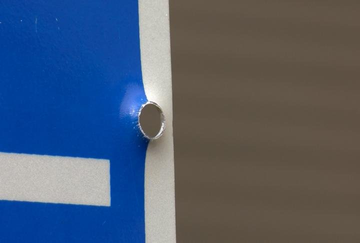 A bullet pierced the handicap parking sign outside Ayers' home
