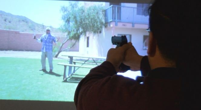 Ron Ferguson participates in a police use of force training simulator.