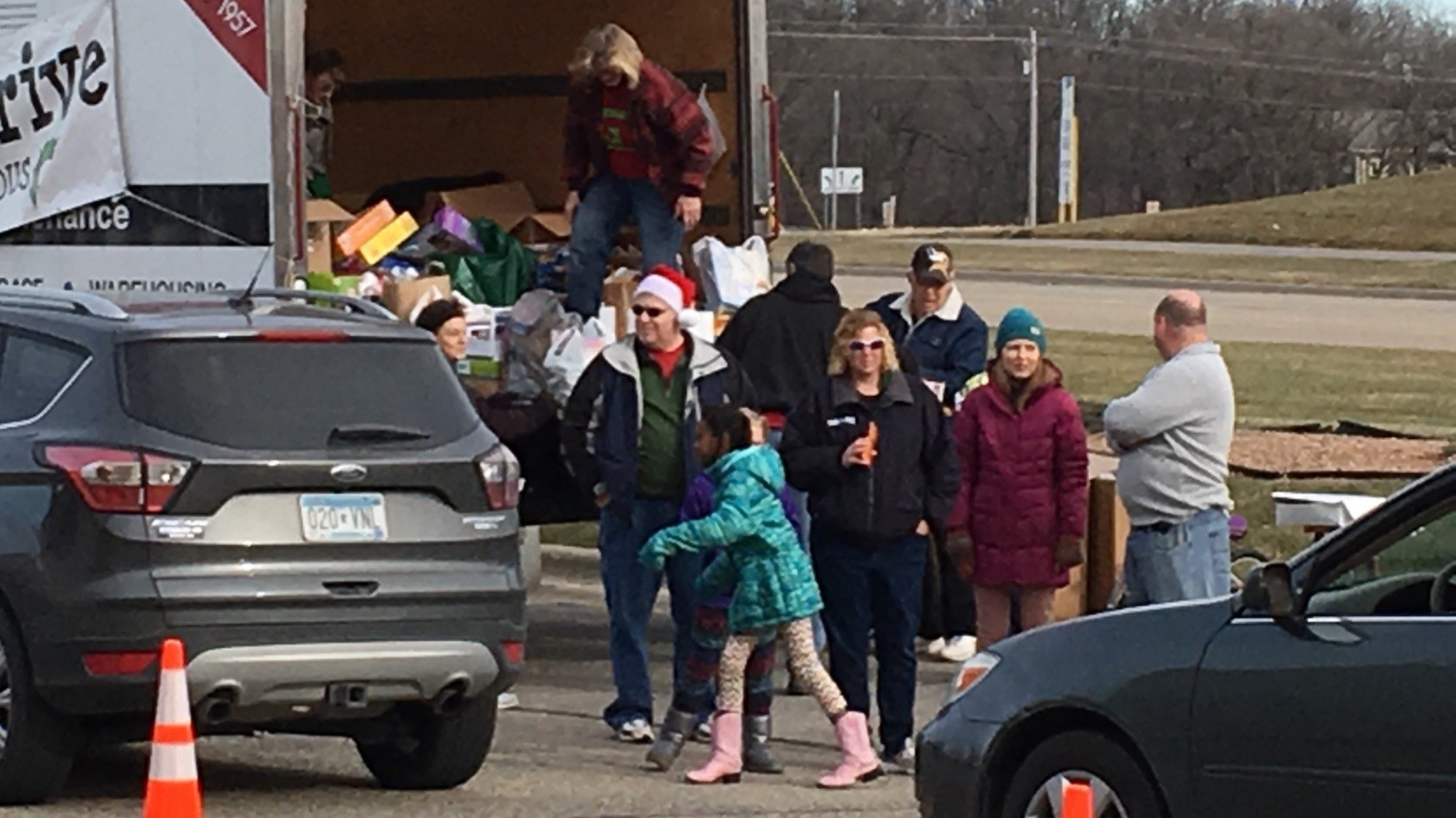 Jess Abrahamson and daughter Bereket were among those helping greet people dropping off toys
