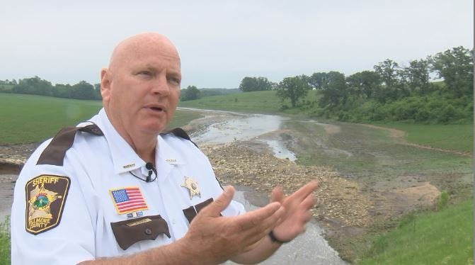 Sheriff Tom Kaase assessing flash flood damage on Sunday
