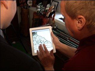 Rep. Gene Pelowski (DFL) of Winona shows NewsCenter's Peter Schuneman the maps