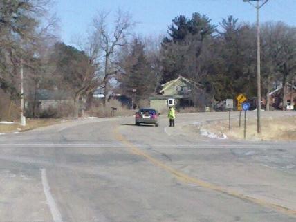 Minnesota State Patrol officer studies crash scene Saturday morning (Photo by Axel Gumbel)