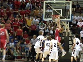 Austin's Tom Aase dunks for the win