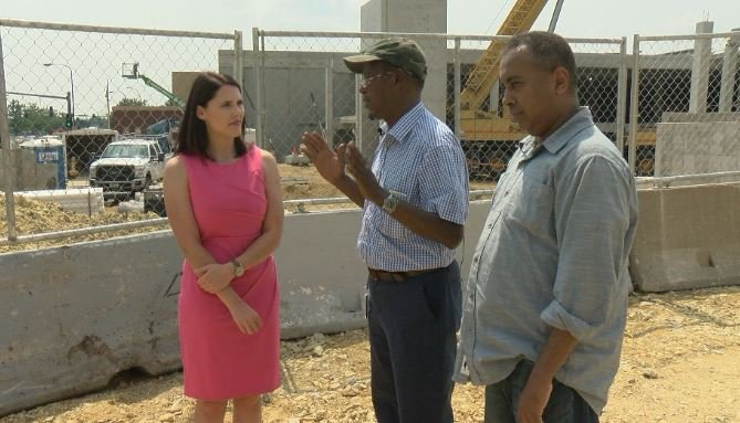 KTTC's Shannon Rousseau speaking with Aweys Osman (R) and his translator Hussein Haajia (L).
