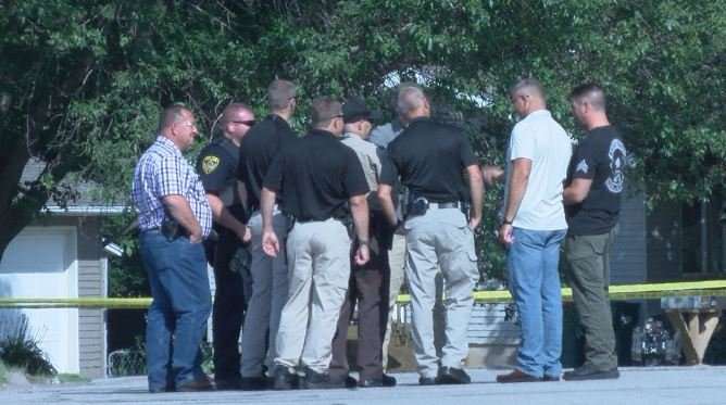 Officers compare findings before sounding the all-clear in Eyota