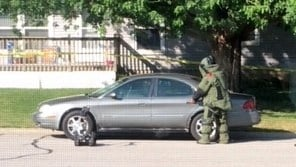 St. Paul Bomb Squad checks suspect's car in Eyota (Photo: Jackie Ihrke)