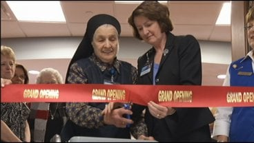 Sister Generose cuts the ribbon to open &quot;Sisters' Crossing&quot;