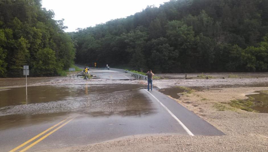 Raging Root River damages Highway 43 bridge Sunday near Choice, Minnesota (Photo by Kari Nerstad)