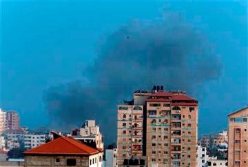 (AP Photo/Lefteris Pitarakis). Smoke from an Israeli strike rises over Gaza City, Tuesday, July 22, 2014.