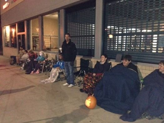 People wait outside Rochester Crossroads AT&T