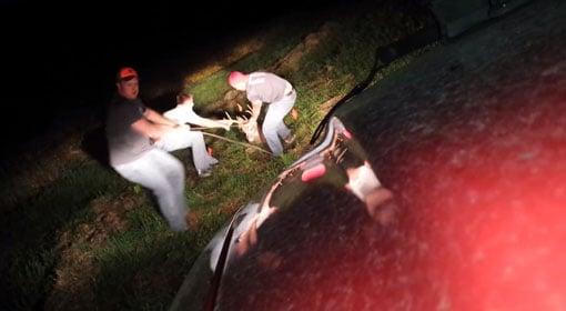 Eric Smorstad, Gavin Nimrod and Bryton Meyer pull a buck from a sinkhole on a Winneshiek County farm.