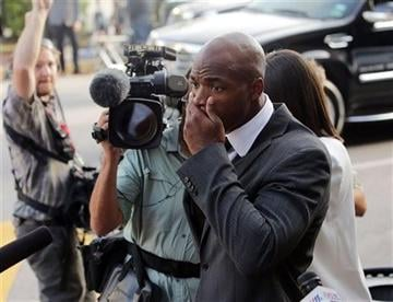 (AP Photo/Houston Chronicle, Billy Smith II). Minnesota Vikings running back Adrian Peterson arrives at court in Conroe, Texas, Wednesday, Oct. 8, 2014.