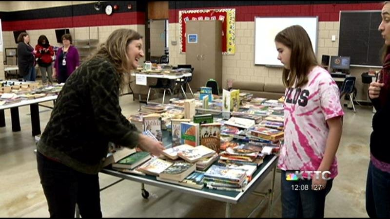 Each John Adams Middle School student can bring home two new books over the holiday break.