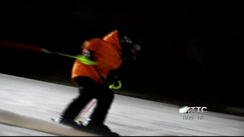 Alpine skiers race down the slopes of Welch Village