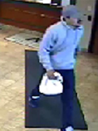 Rochester Police release surveillance photos from credit union robbery
