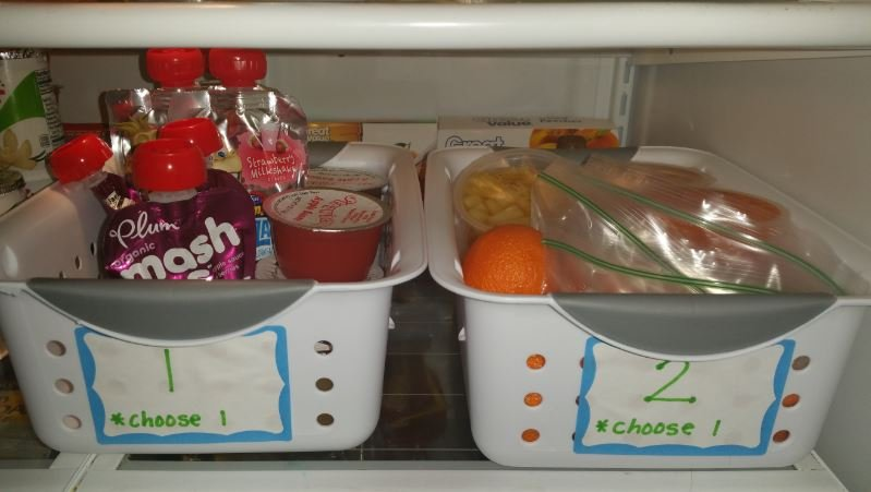 Katie and Brandon's children choose one item from each of four bins to go with their lunch.