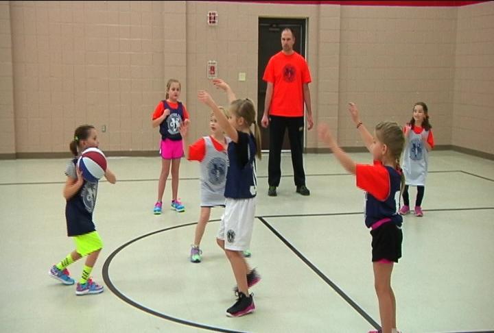 Champion youth basketball league teaches kids importance for Champion motors waterloo iowa