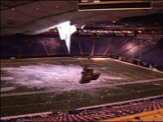Metrodome roof ruptured from the weight of ice and snow