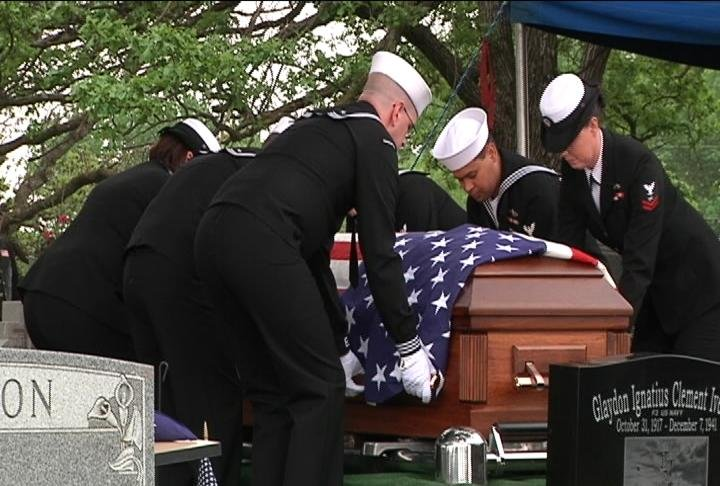 Glaydon's casket reaches its final resting place at Oak Lawn Cemetery