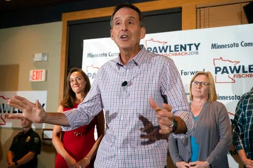 (Glen Stubbe/Star Tribune via AP). Tim Pawlenty stands with his wife, Mary, background left, and running mate Michelle Fischbach as he concedes his run for governor at his election night gathering at Granite City Food and Brewery, Tuesday, Aug. 14, 2018.